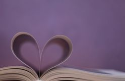 Book , heart shape Stock Photos