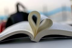 Book and Heart Sing. Heart symbol Stock Photo