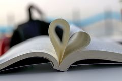 Book and Heart Sing. Heart symbol Stock Image