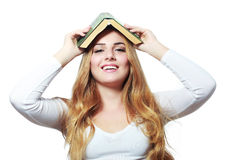 Book on her head Royalty Free Stock Image