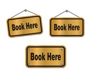 Book here - bronze signs Stock Images