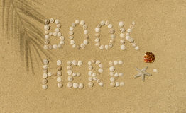 Book here written in sand Stock Photos