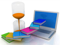 Book, an hourglass and a laptop Royalty Free Stock Image