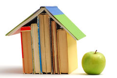 Book house and apple Royalty Free Stock Images