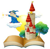 A book with an image of a castle and a magician Royalty Free Stock Photo