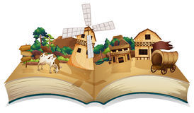 A book with an image of a village and wooden arrowboards Stock Image