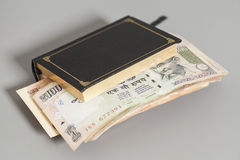 Book with Indian Currency Rupee bank notes Stock Photography