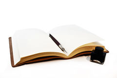 Book ink and pen. A small book with a pen and ink Stock Image