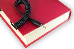 Book with Jack plug Royalty Free Stock Photo