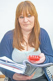 Book-keeper doing monthly accounts. Stock Photography
