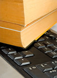 Book on the keyboard Royalty Free Stock Photography