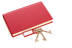 Book and keys. Book and some keys isolated over white background stock photos