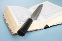 Book and knife Royalty Free Stock Images