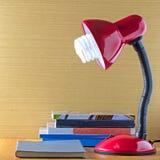 Book and lamp Stock Photos