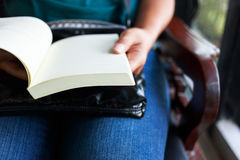 Book on lap Royalty Free Stock Photo