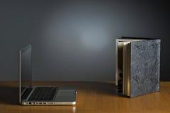 Book and laptop Stock Photos
