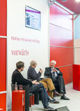 Book launch at the vorwaerts stand at the Frankfurt Book Fair 2014. FRANKFURT AM MAIN, GERMANY - OCT 12, 2014: Panel discussion with Klaus von Dohnanyi (right) stock images