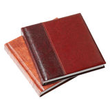 Book in leather-bound. Leather book on an isolated white background Stock Images