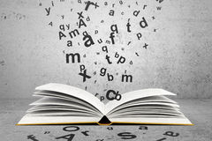 Book with letters Stock Images