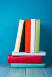 Book in library on blue wooden shelf. Education background with copy space for text. Toned photo Stock Photography