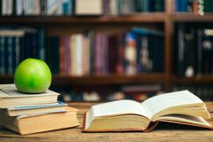 The book in the library school, university, college on the table. Learning and study concept. Copy space. The book in the library school, university, college on stock image
