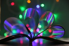 The book lies on the table shimmers with christmas lights. On the background of multi-colored bokeh royalty free stock photos