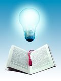 Book and light bulb. Photo manipulation Stock Photo