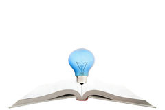 Book with light bulb Stock Photography