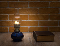 The book by the light of an old lamp Royalty Free Stock Images