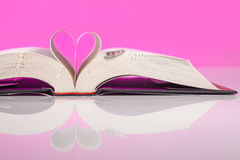 The Book of Love. Book of love isolated on pink background. Love inspired stories show that faith, forgiveness and hope have the power to lift spirits and change Royalty Free Stock Photography
