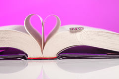 The Book of Love. Book of love isolated on pink background. Love inspired stories show that faith, forgiveness and hope have the power to lift spirits and change royalty free stock image