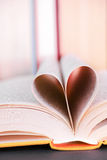 Book love. Pages of a book forming a heart for your love, literature or education concepts - focus is best on the top of the heart, copy space is above the heart Royalty Free Stock Photography