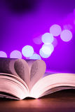 Book with low light and pink bokeh Stock Image