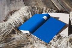 Book lying on Fur carpet, close-up Stock Image