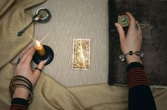 Book of magic. Future reading. Book of magic on fortune teller concept. Book of magic. Tarot cards on fortune teller desk table. Future reading. Woman witch Royalty Free Stock Images