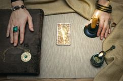 Book of magic. Future reading. Book of magic on fortune teller concept. Book of magic. Tarot cards on fortune teller desk table. Future reading. Woman witch Stock Photo