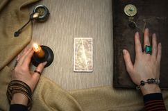 Book of magic. Future reading. Book of magic on fortune teller concept. Book of magic. Tarot cards on fortune teller desk table. Future reading. Woman witch Stock Photos
