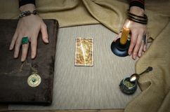 Book of magic. Future reading. Book of magic on fortune teller concept. Book of magic. Tarot cards on fortune teller desk table. Future reading. Woman witch Stock Photography