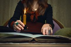 Book of magic. Future reading. Book of magic on fortune teller concept. Book of magic. Tarot cards on fortune teller desk table. Future reading. Woman witch Stock Images