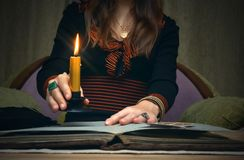 Book of magic. Future reading. Book of magic on fortune teller concept. Tarot cards on fortune teller desk table. Future reading. Woman witch reads a ancient Stock Photo