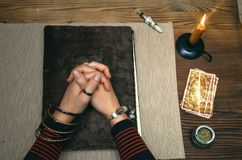 Book of magic. Future reading. Book of magic on fortune teller concept. Book of magic. Tarot cards on fortune teller desk table. Future reading. Woman witch Royalty Free Stock Image