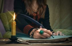 Book of magic. Future reading. Book of magic on fortune teller concept. Tarot cards on fortune teller desk table. Future reading. Woman witch writes a magic royalty free stock images