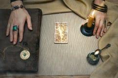 Book of magic. Tarot cards. Future reading. Fortune teller concept. Book of magic. Tarot cards on fortune teller desk table. Future reading. Woman witch reads a Royalty Free Stock Photos
