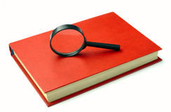 The book and magnifier Royalty Free Stock Photography