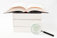 Book and magnifying glass. Books with magnifying glass on white background Royalty Free Stock Photos