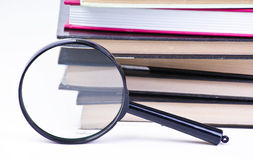 Book with magnifying glass Royalty Free Stock Photography