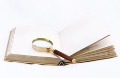 Book with magnifying glass Stock Photo