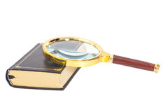 Book with magnifying glass Royalty Free Stock Image