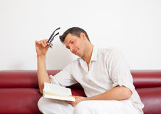 Book man couch Royalty Free Stock Image