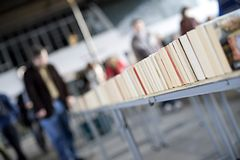 Book market. A book market on the embankment of the River Thames in London, UK, shot with a very narrow depth of field to throw the people at the fair out of Royalty Free Stock Image